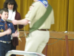 Wesley receiving his arrow from an Eagle Boy Scout.