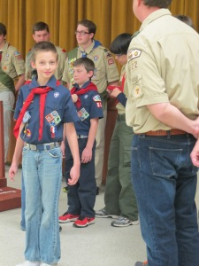 The Boy Scouts finished putting on Wesley's new neckerchief.