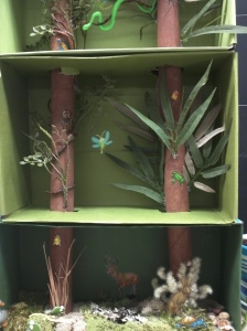 A tri-level diorama to show the green mamba snake.