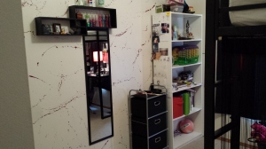 AFTER: splattered wall with shelves, new mirror and rolling cart.